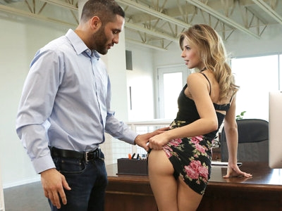 There have been rumors that secretary Jillian Janson is fucking her boss Damon Dice, and they're all absolutely correct. The flirty blonde can't stop thinking of Damon's hot body, especially when he sends her naughty texts. It's no surprise when he walks in on her with her miniskirt pushed up and her hands down her panties as she dreams of him. After enjoying the show for a moment, he walks over to help her out with her needs.Soon Jillian finds herself seated on the desk while Damon knees in front of her. He fondles her clit through her underwear, and then pulls the fabric away from her landing strip twat. Once she is bared for him, he leans forward for a proper pussy feast. With his tongue, fingers, and lips working together, he soon has his willing secretary moaning her excitement.Getting to his feet, Damon pauses to give Jillian a chance to enjoy some mutual masturbation. When she's ready, she positions the head of his dick at the entrance to her snatch and then gasps with excitement when he pushes in. Damon's slow strokes speed up in time with the small sounds of need that Jillian can't help but make at the naughtiness of their workplace coupling, and soon he is going all out for both of their pleasure.As her body pulses with the remnants of her first climax, Jillian hops to her feet and leans forward over the desk so that Damon can smack her full rump. Then he presses into her again, going deep and leaving nothing on the table in his taking of his lusty secretary. Jillian's medium boobs quiver with the force of his strokes as he delivers a proper pussy pounding that merely pauses when Jillian squirts her excitement everywhere.Taking their fuck fest to the office chair, Damon sits down and then pulls Jillian on top of him. She slides down easily until she is impaled on his stiffie. Once she's secure, she starts moving her hips in a frantic rhythm while Damon squeezes her tender titties. This position is so good for Jillian that she explodes with passion once again.Damon isn't able to hold out for long after that demonstration of pure lust. Dropping to her knees, Jillian takes care of Damon's last few moments of need. Then she aims his hardon so that his cumshot covers her breasts, leaving her marked forever as his.
