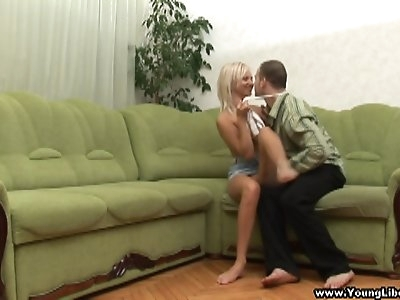 This blonde libertine doesn't even need a bed to give her boyfriend a fucking he'll never forget. A large green corner sofa will do just fine when she gets face-fucked and follows with taking cock balls deep in her tight young pussy. She wants more and more begging her lover to keep fucking her from behind, on top and any other way he wants. What an insatiable teeny!